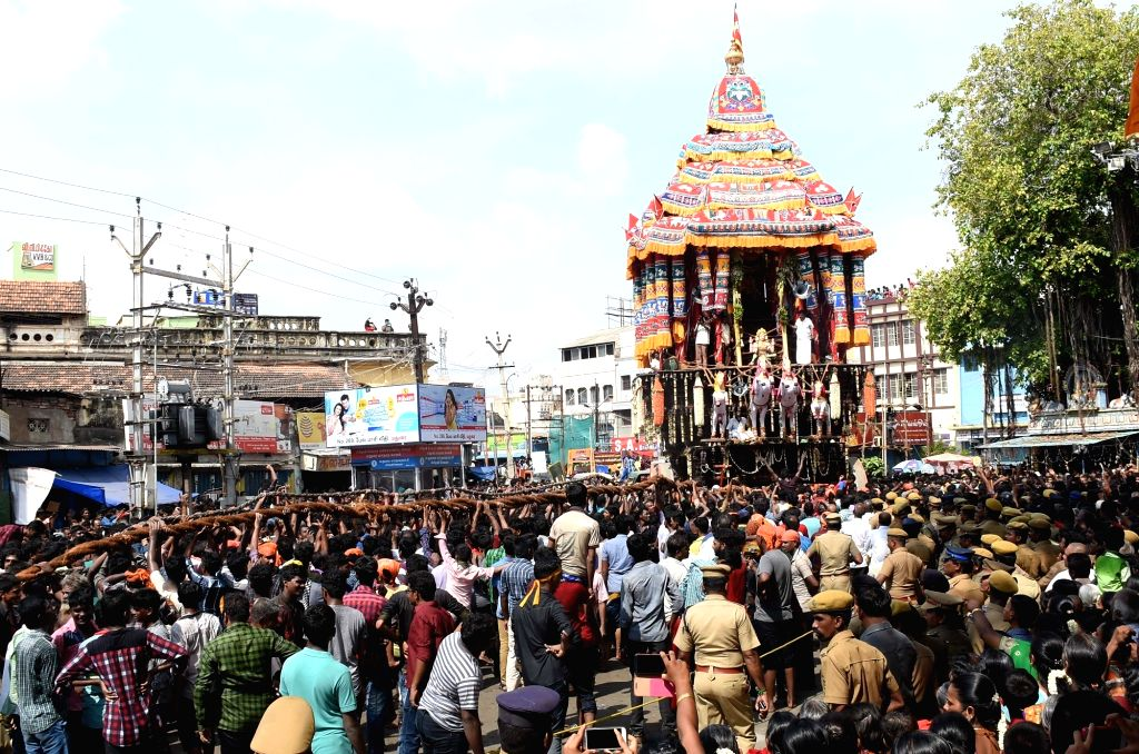 Devotees pull the chariot of Meenakshi Sundareswarar during Chithirai Festival celebrations in Madurai on April 20, 2016.