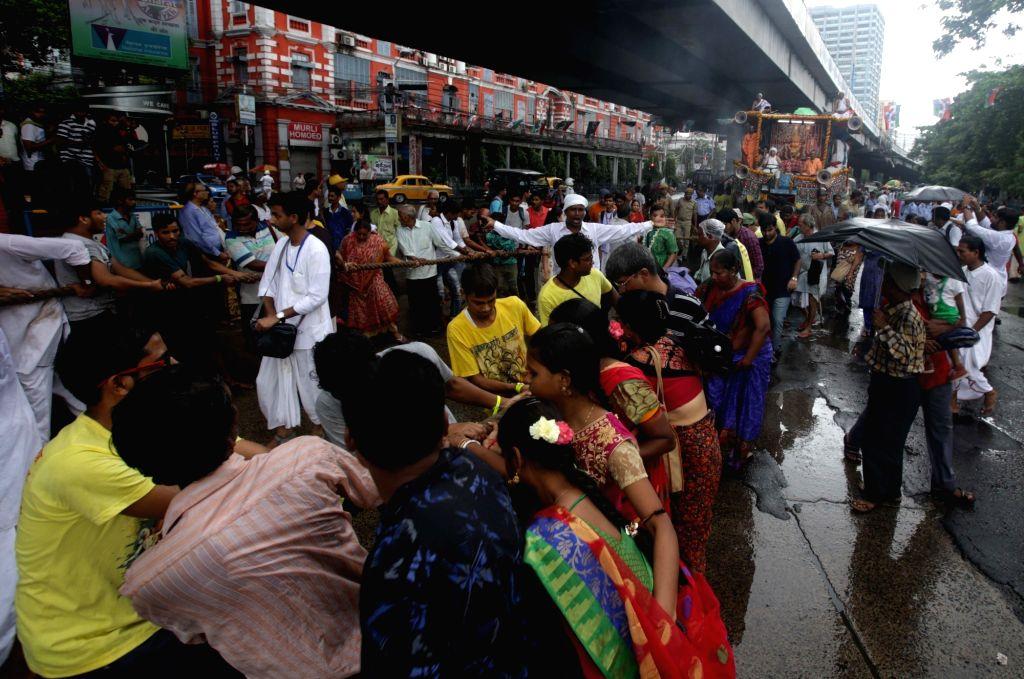 Devotees pull the chariots during 'Ulta Rath Yatra'- the return of the chariots of Lord Jagannath and his two siblingsLord Balaram and Goddess Subhadra, in Kolkata on July 22, 2018.