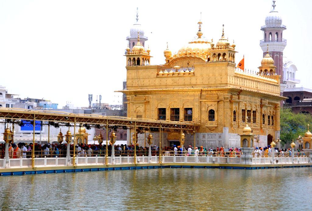 Devotees queue up at the Golden Temple to pay their obeisance on 'Gurta Gadhi Diwas' of sixth Sikh Guru, Guru Hargobind in Amritsar on June 7, 2018.