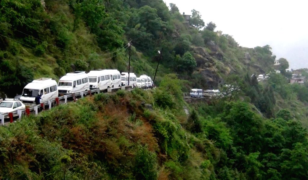 Devotees stranded in Chamoli district of Uttarakhand after Badrinath Yatra got suspended, on May 14, 2014.