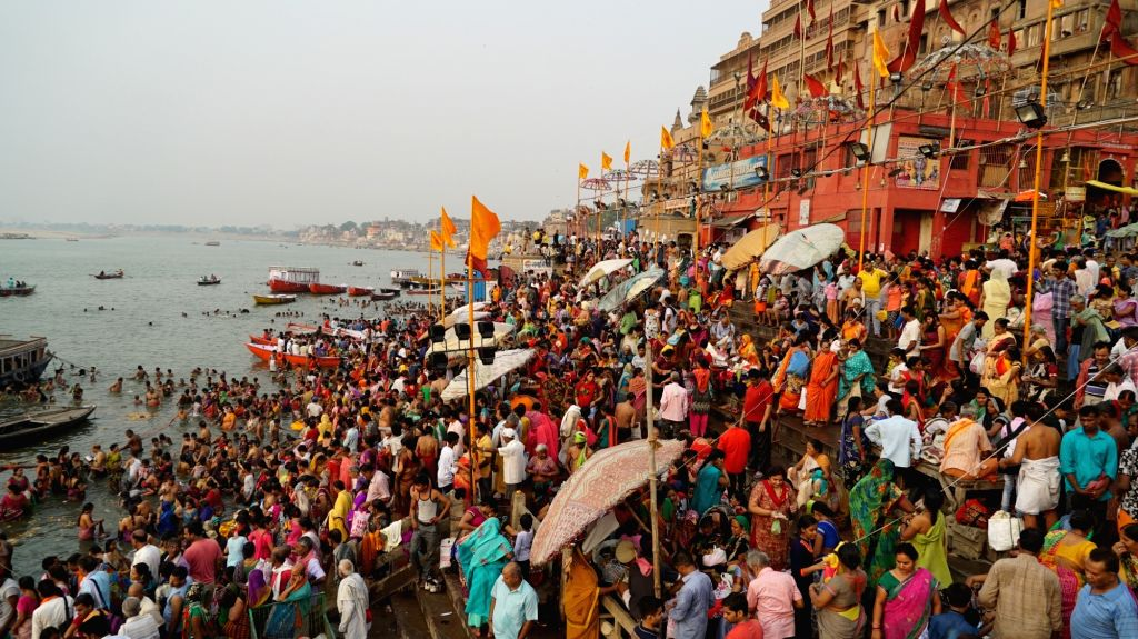 Devotees take a holy dip in river Ganga on the occasion of Ganga Dussehra, in Varanasi on May 24, 2018.