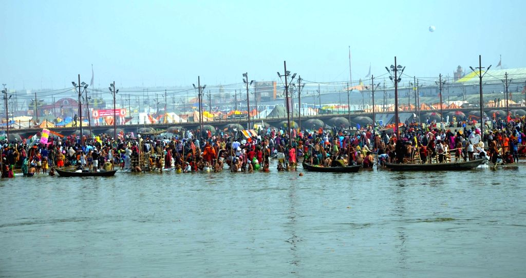 Devotees take a holy dip in Sangam - the trinity of rivers Ganga, Yamuna and the mythical Saraswati - on the occasion of 'Mauni Amavasya' duirng Kumbh Mela, in Prayagraj on Feb 4, 2019.
