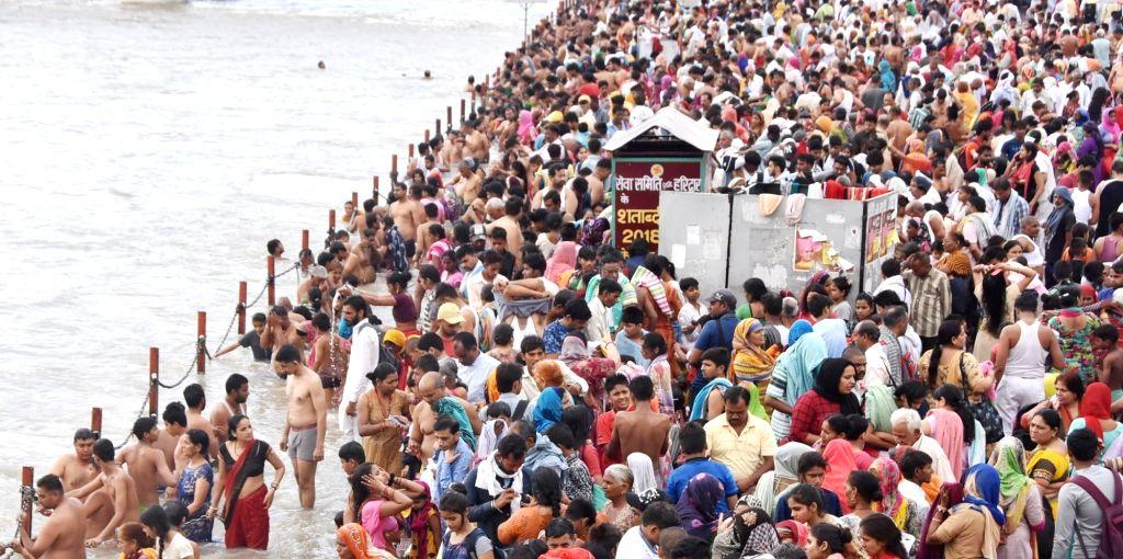 Devotees take a holy dip in the Ganga river on the occasion of Ganga Dussehra, at the Har Ki Pauri Ghat in Haridwar, Uttarakhand on June 12, 2019.