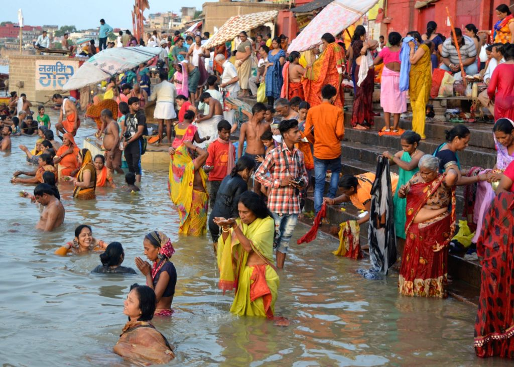 "Devotees take a holy dip in the Ganga river on ""Guru Purnima"" in Varanasi on July 16, 2019."