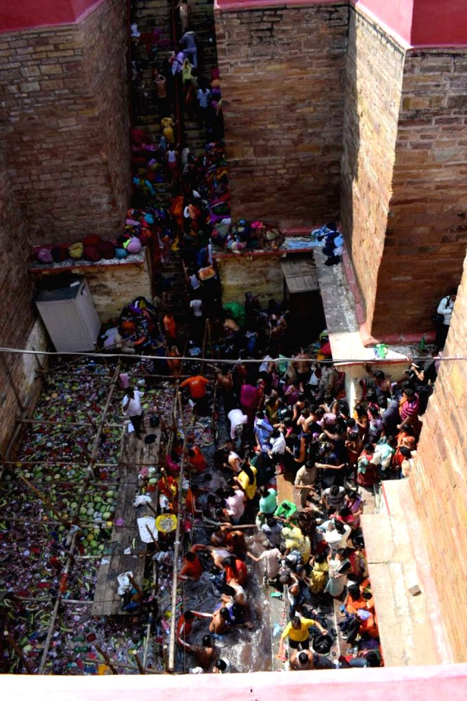 Devotees take bath in the Lolark Kund to pray for the fulfillment of their desire to have children, in Varanasi on Sept 15, 2018.