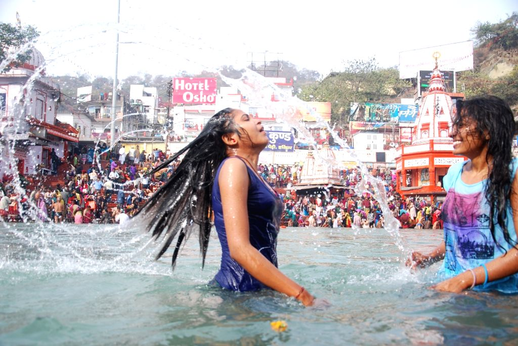 Devotees take holy dip in the Ganga river during Ardh Kumbh, in Haridwar, on Jan 14, 2016.
