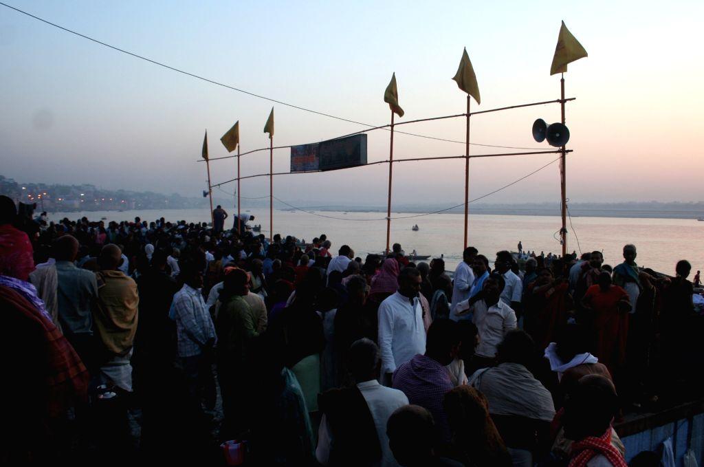 "Devotees take holy dip in the Ganga river on ""Makar Sankranti"" in Varanasi on Jan 14, 2017."