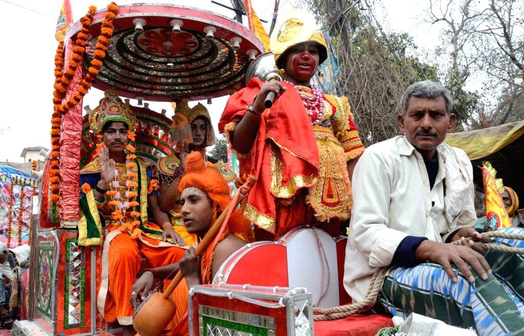 "Devotees take out a procession ""Bhole ki baraat"" or ""Shiva's baraat"" on the occasion of Maha Shivaratri in Patna on Feb 13, 2018."
