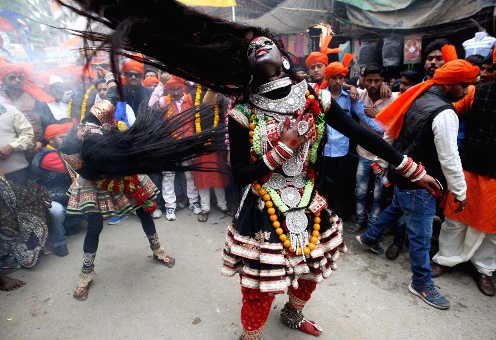 "Devotees take out a procession ""Bhole ki baraat"" or ""Shiva's baraat"" on the occasion of Maha Shivaratri in Allahabad on Feb 13, 2018."