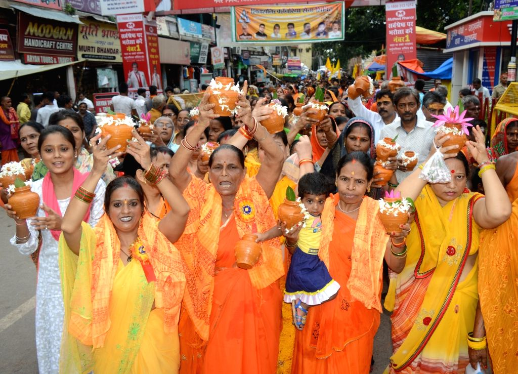 Devotees take out 'Kalash Yatra' from the banks of Ganga river to Kashi Vishvanath Temple in the Hindu holy month of 'Sawan' in Varanasi on Aug 9, 2019.