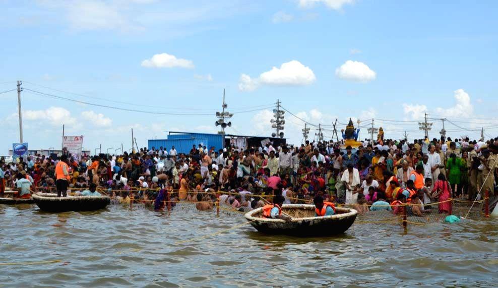Devotees takr holy dip in the Krishna river during Krishna Pushkaralu in Mahbubnagar district ofTelangana on Aug 21, 2016.
