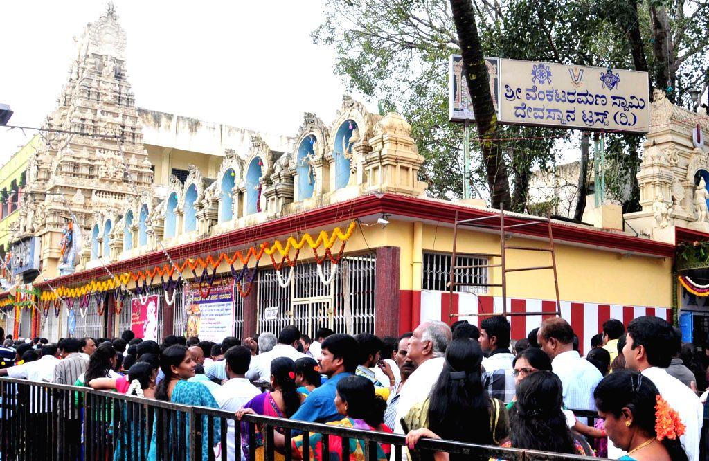 Devotees throng a temple on Vaikuntha Ekadashi in Bengaluru, on Jan 1, 2015.