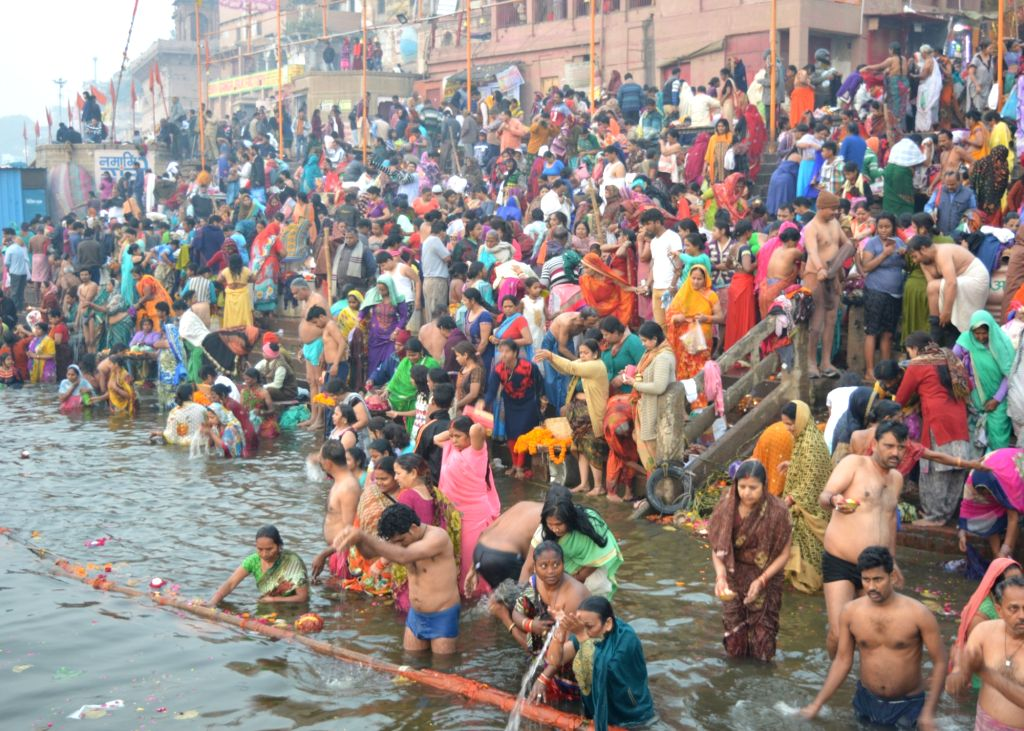 Devotees throng Ganga ghat to take a holy dip in the river on the occasion of Mauni Amavasya in Varanasi, on Feb 4, 2019.