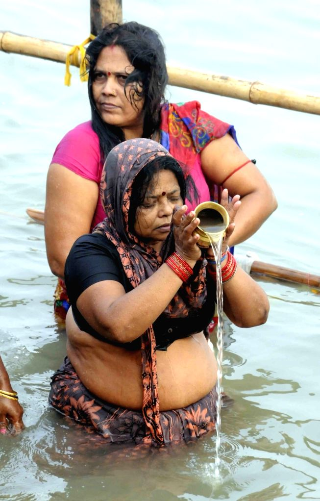 Devotees throng Ganga Ghats on the Nahai Khai (1st day of Chhath Puja) in Patna on Nov 15, 2015.
