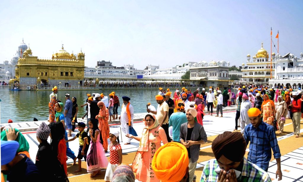 Devotees throng Golden Temple on the occasion of the birth anniversary of fifth Sikh master Sri Guru Arjan Dev Ji, in Amritsar on April 7, 2018.