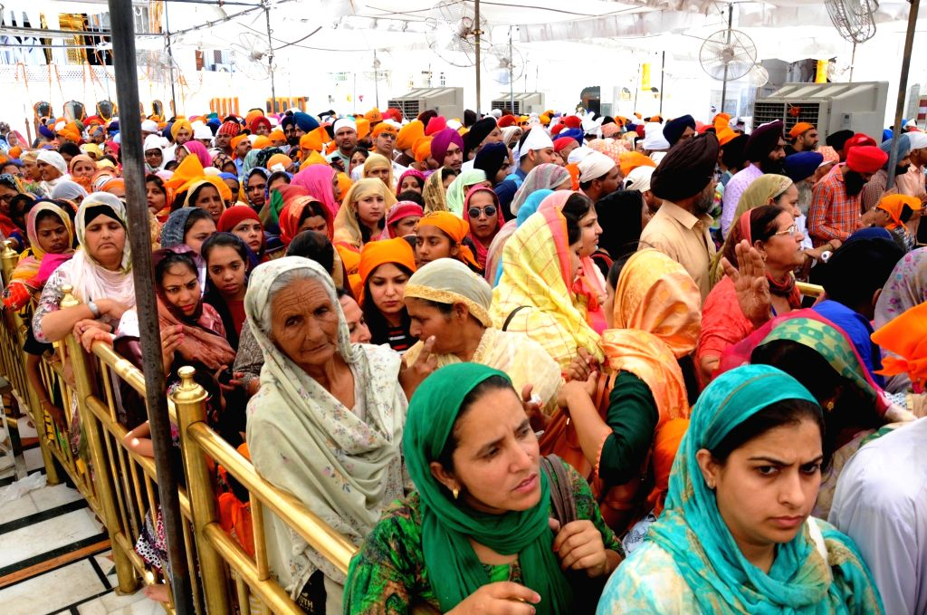 Devotees throng Golden Temple on the occasion of 'Gurta Gaddi Diwas' of the sixth Sikh Guru, Guru Hargobind Sahib in Amritsar on May 27, 2019.