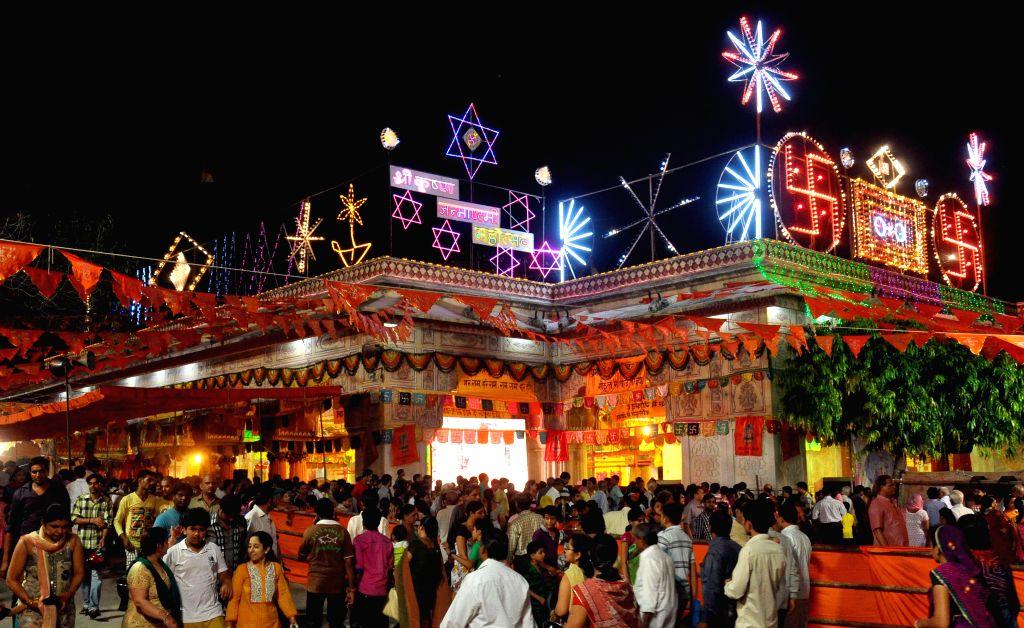 Devotees throng Govind Dev Ji Temple on Janmashtami in Jaipur on Aug 17, 2014.