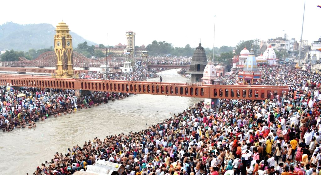 Devotees throng Har Ki Pauri to take a holy dip in the waters of Ganga river on the occasion of 'Somvati Amavasya' (also called Vat Savitri Puja) in Haridwar, Uttarakhand on June 3, 2019.