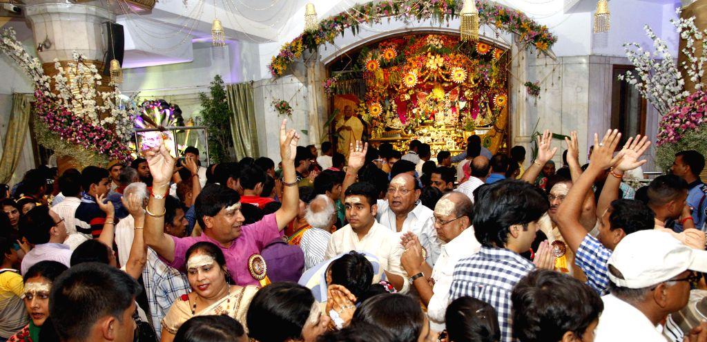 Devotees throng ISKCON Temple on Janmashtami at ISKCON Temple in New Delhi on Aug 18, 2014.
