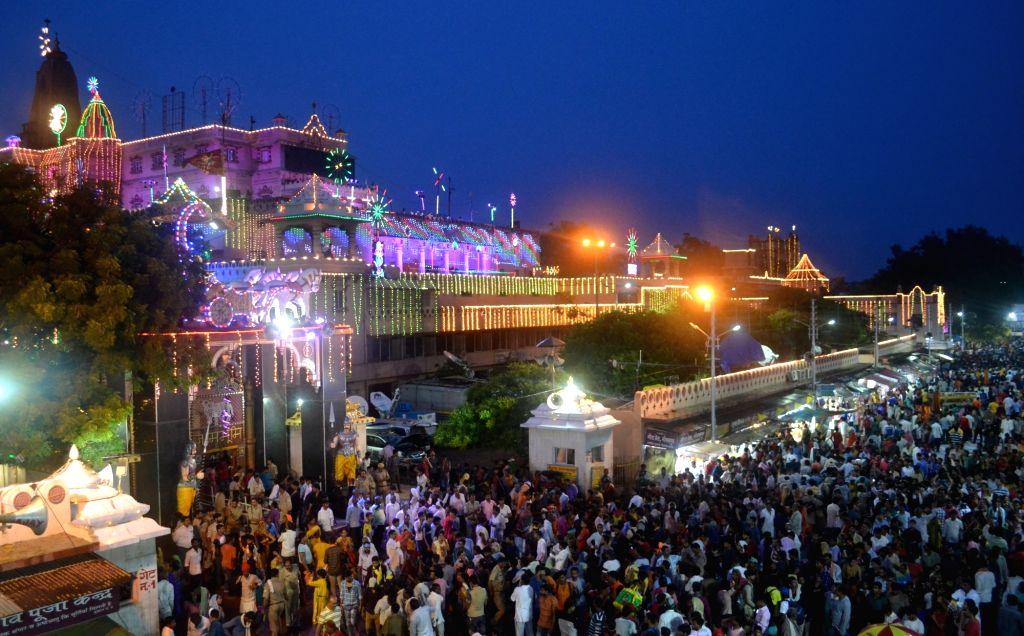 Devotees throng Krishna Janmasthan Temple on Krishana Janmashtami, in Mathura on Aug 24, 2019.