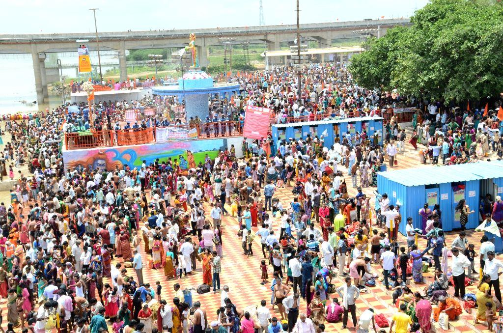 Devotees throng Pushkara Ghat to ta take a holy dip during Krishna Pushkaralu river festival in Karimnagar of Telangana on Aug 14, 2016.