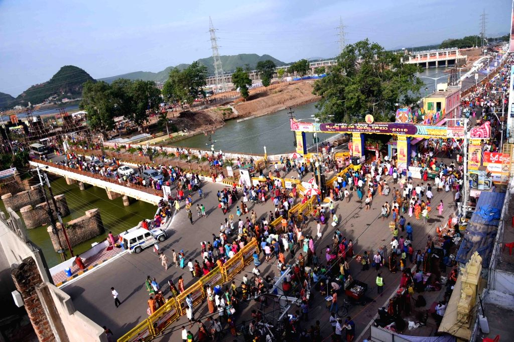 Devotees throng Pushkara Ghat to ta take a holy dip during Krishna Pushkaralu river festival at Durga ghat in Vijayawada on Aug 15, 2016.