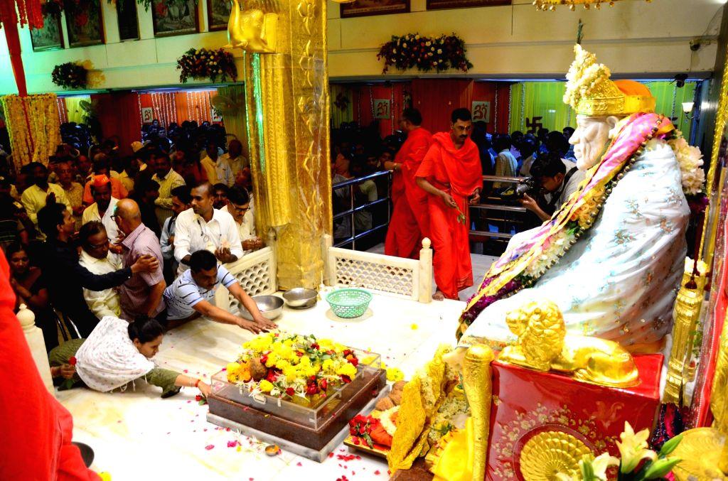 Devotees throng Sai Baba Temple on Guru Purnima in Nagpur on July 16, 2019.