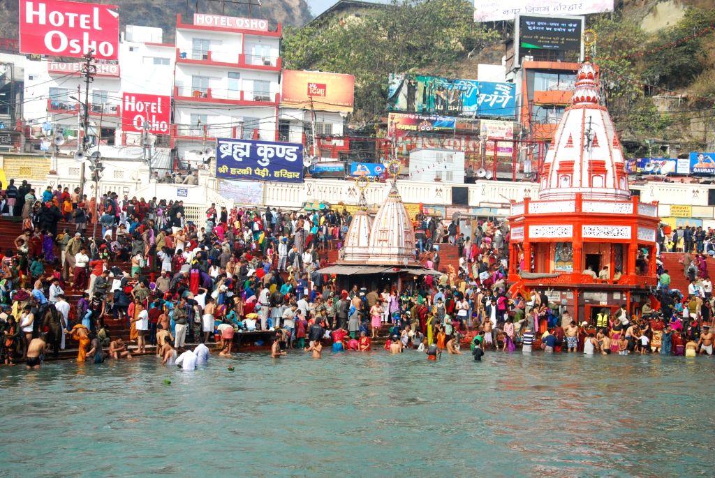 Devotees throng the Ganga ghats in Haridwar during Ardh Kumbh  on Jan 14, 2016.