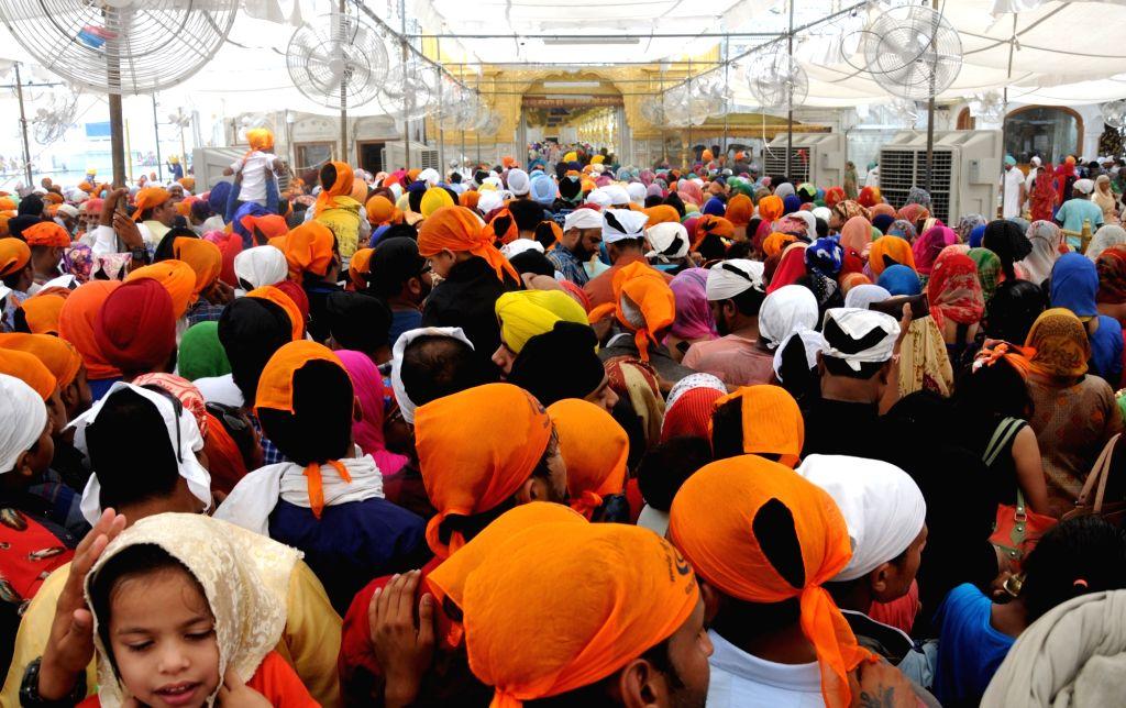 Devotees throng the Golden Temple on 'Gurta Gadhi Diwas' of sixth Sikh Guru, Guru Hargobind in Amritsar on June 7, 2018.
