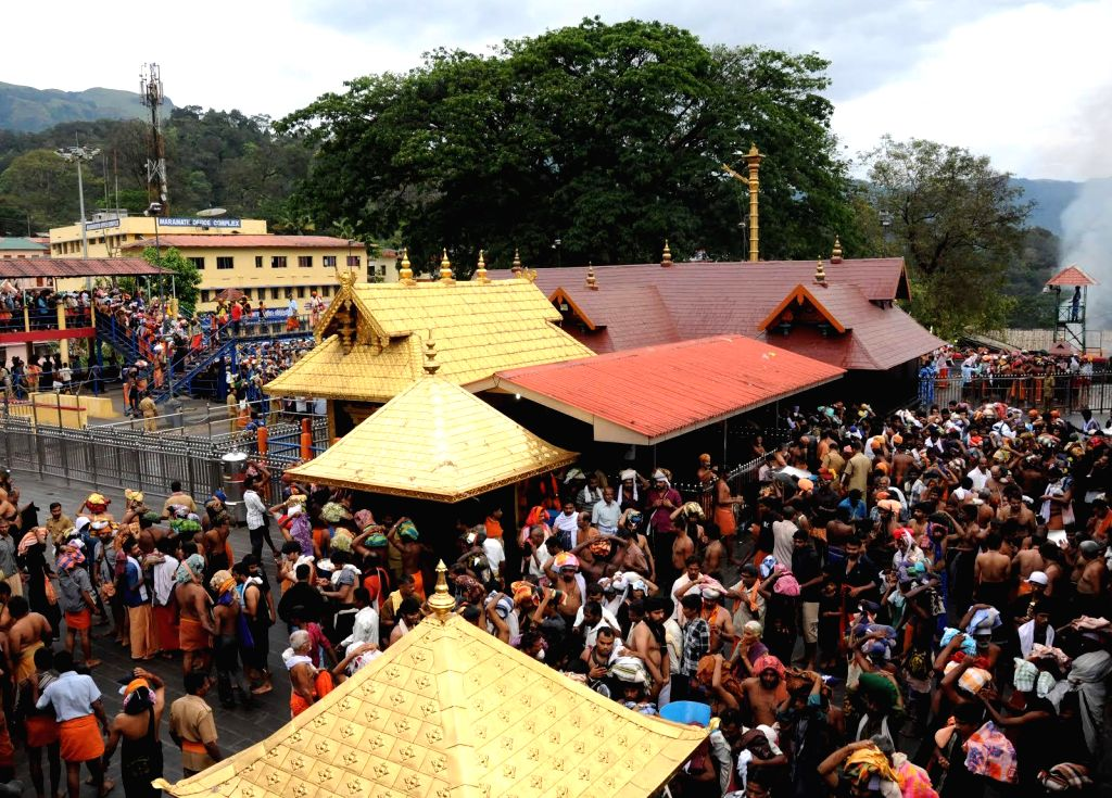 : Devotees throng the Lord Ayyappa temple in Sabarimala on Dec. 07, 2013. (Photo: IANS).