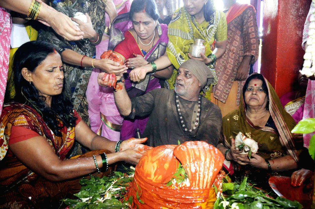 Devotees worship lord Shiva at a temple during Saawan holy month in Patna, on Aug 10, 2015.