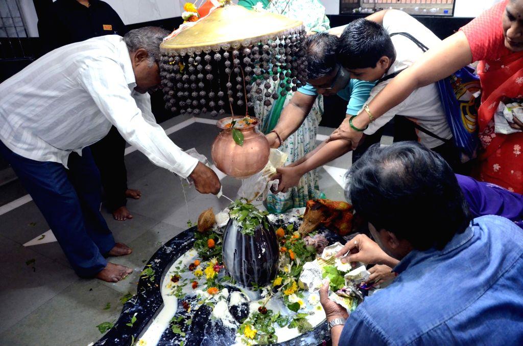 Devotees worship lord Shiva on Maha Shivratri, in Mumbai, on  March 4, 2019.