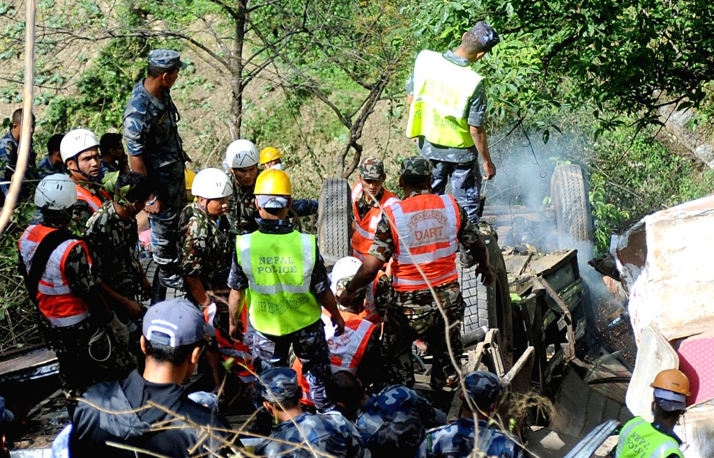 Dhading (Nepal): Nepalese security personnel carry out rescue operations at the site where a bus carrying 17 Indian pilgrims met with an accident on Prithvi Highway in Dhading district of Nepal on ...