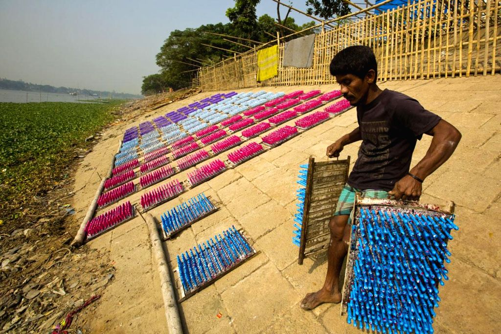 A worker at a balloon factory at Kamrangirchar in Dhaka, Bangladesh  on Nov 23, 2014.