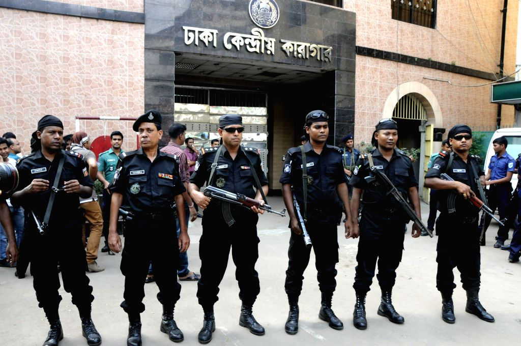 Rapid Action Battalion stand guard in front of the gate of the Central Jail before Mohammad Kamaruzzaman's execution in Dhaka, Bangladesh, April 11, 2015. ...