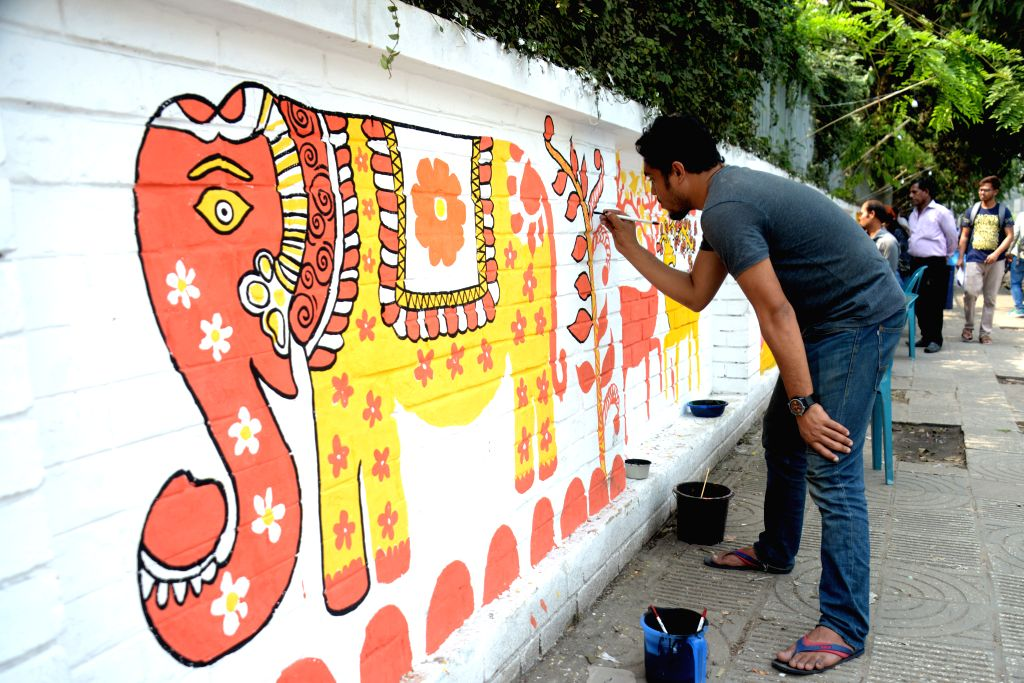DHAKA, April 12, 2018 - A Dhaka University student paints on a wall in preparation for celebration of Bengali New Year 1425 which falls on April 14, in Dhaka, Bangladesh, April 12, 2018.