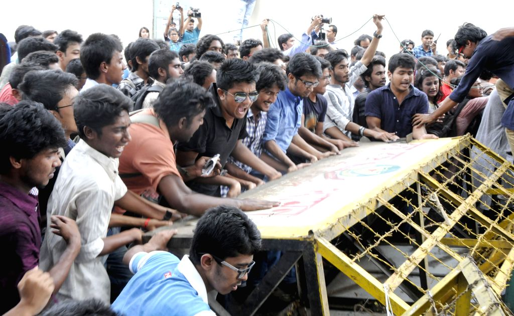 Bangladeshi youths try to remove police barricades during a protest against sexual assaults on women during the celebration of Bengali New Year in Dhaka, Bangladesh, ...