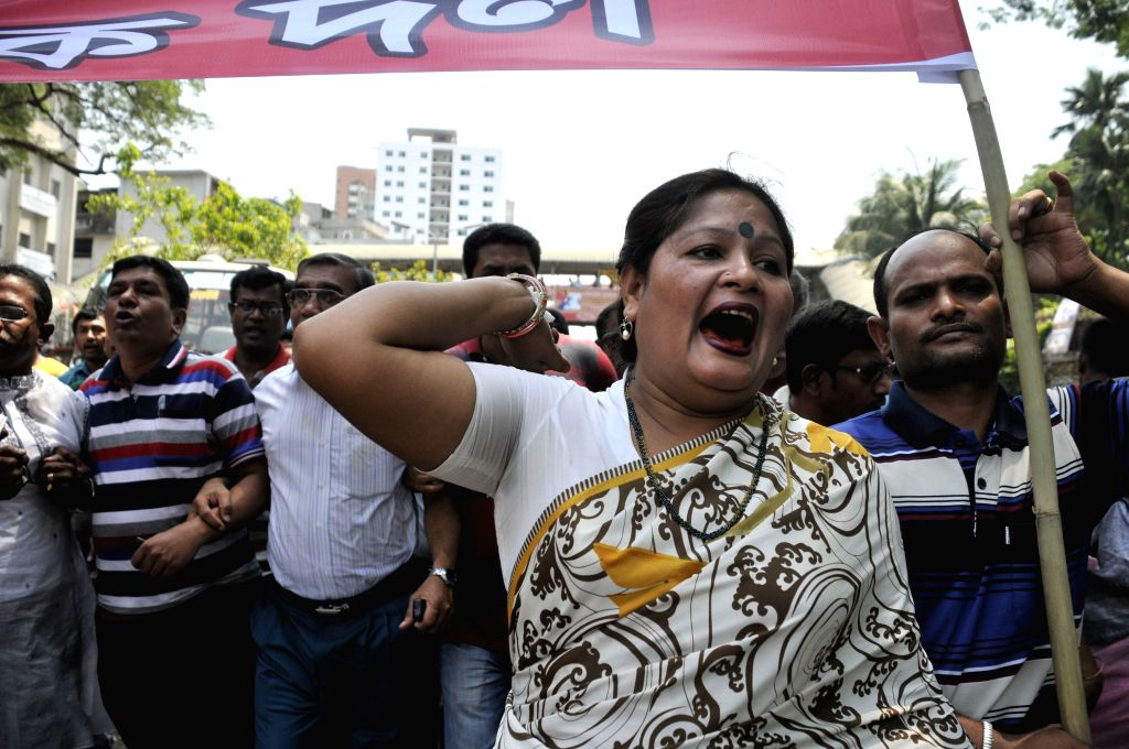 A woman garment worker shouts slogans during a protest rally demanding proper compensation in front of the National Press Club in Dhaka, Bangladesh, April 23, 2014. .
