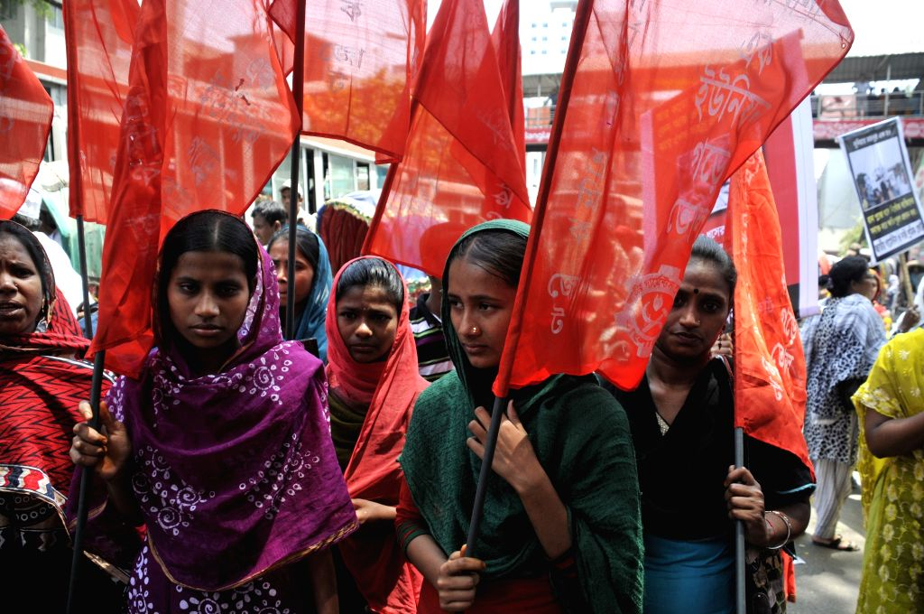 Women garment workers take part in a protest rally demanding proper compensation in front of the National Press Club in Dhaka, Bangladesh, April 23, 2014. At least ..