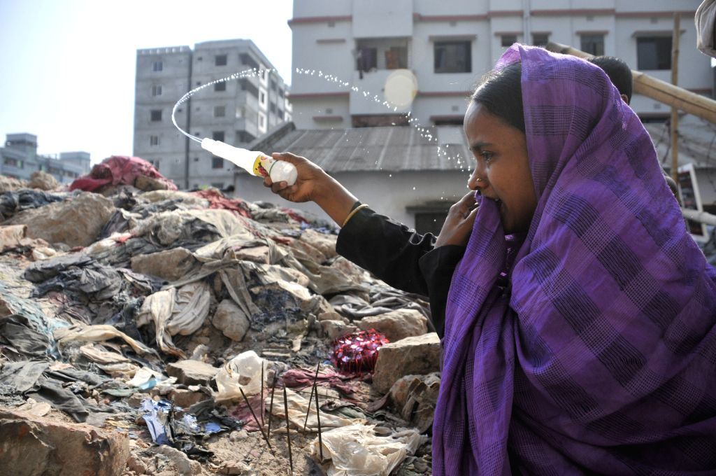 A relative of victim mourns at the site of Rana Plaza building collapse during a commemoration in Savar, on the outskirts of Dhaka, Bangladesh, April 24, 2014. ...
