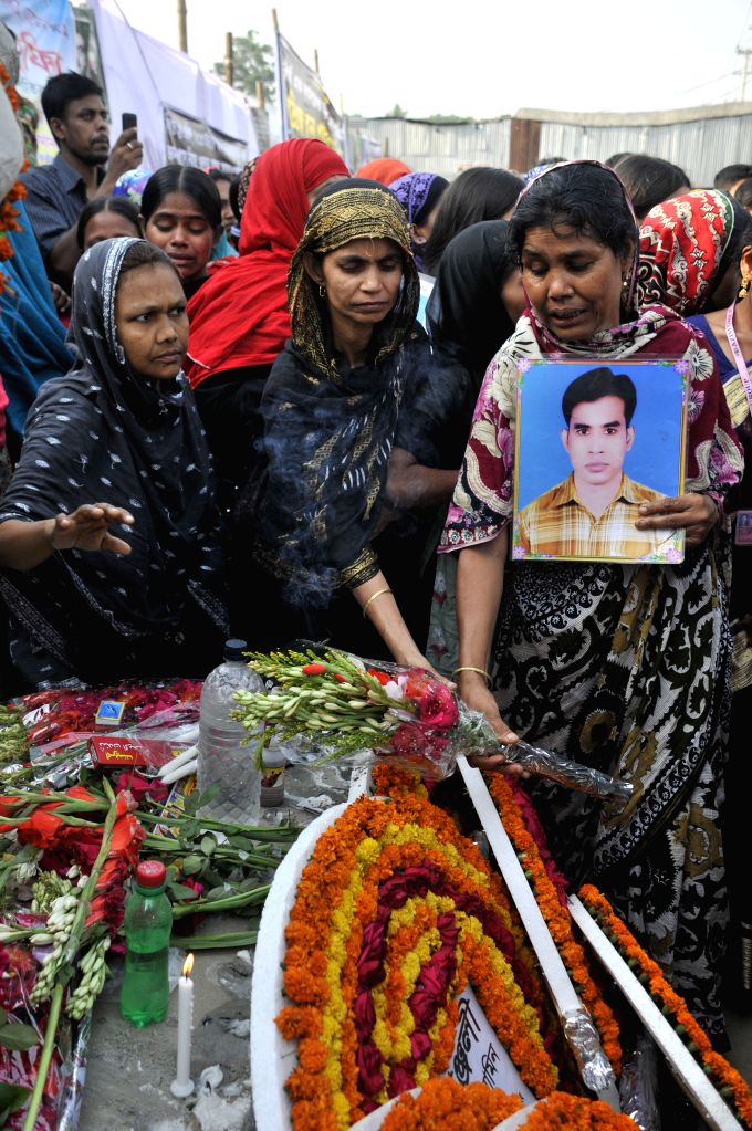 Relatives of victims mourn at the site of Rana Plaza building collapse during a commemoration in Savar, on the outskirts of Dhaka, Bangladesh, April 24, 2014. ...