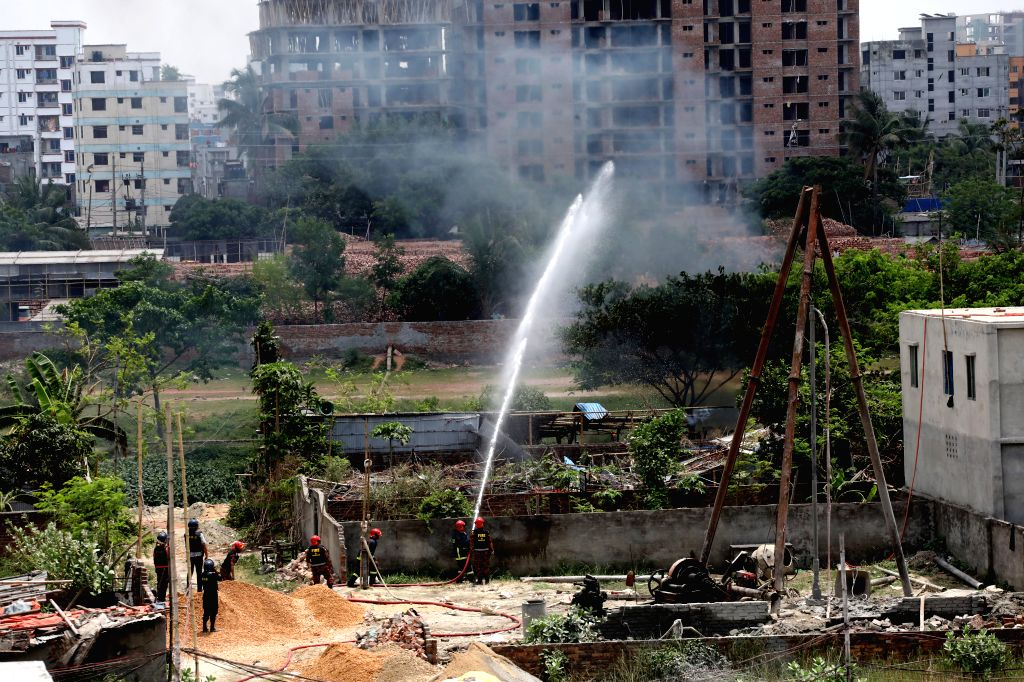 DHAKA, April 29, 2019 - Firefighters spray water on the roof of a burning militant hideout during an operation in Dhaka, Bangladesh, April 29, 2019. Two suspected militants were confirmed dead in a ...