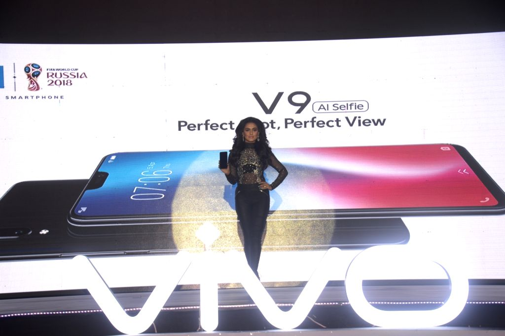 DHAKA, April 3, 2018 - A model presents a Vivo V9 at a launching ceremony in Dhaka, Bangladesh, April 2, 2018. Vivo launched its latest smartphone Vivo V9 here on Monday.