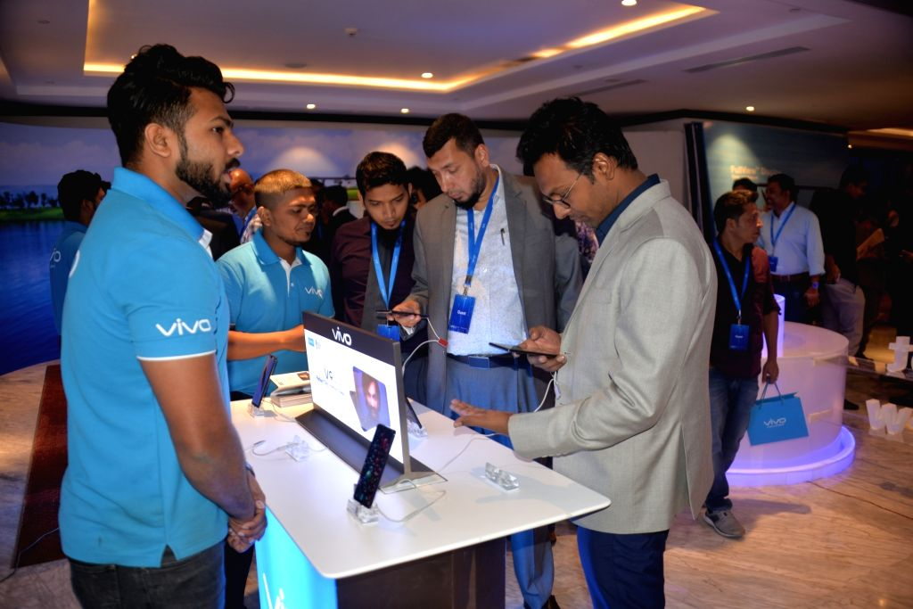 DHAKA, April 3, 2018 - Guests try Vivo V9 at a launching ceremony in Dhaka, Bangladesh, April 2, 2018. Vivo launched its latest smartphone Vivo V9 here on Monday.