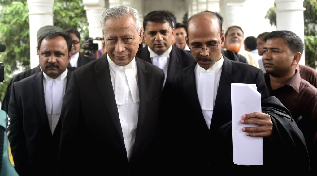 Bangladeshi Attorney General Mahbubey Alam (L, front) arrives at the supreme court for the review petition to a case of Jamaat-e-Islami party leader in Dhaka, ...