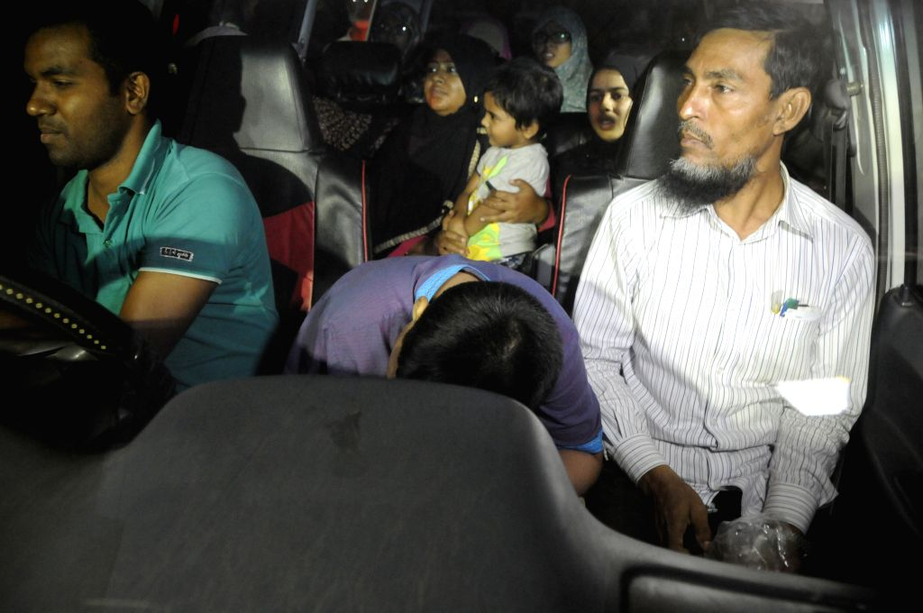 Family members of death-row criminal Muhammad Kamaruzzaman, Bangladesh Jamaat-e-Islami party's assistant secretary general, wait to meet him in Dhaka, Bangladesh, ...