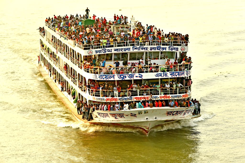 DHAKA, Aug. 10, 2019 - A ferry packed with travelers leaves the Sadarghat Launch Terminal in Dhaka, Bangladesh, Aug. 10, 2019. With the Eid al-Adha holiday approaching, hundreds of thousands of ...