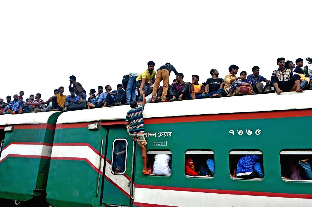 DHAKA, Aug. 10, 2019 - A man climbs up a train at a railway station ahead of the Eid al-Adha holiday in Dhaka, capital of Bangladesh, on Aug. 9, 2019. With the Eid al-Adha holiday approaching, ...