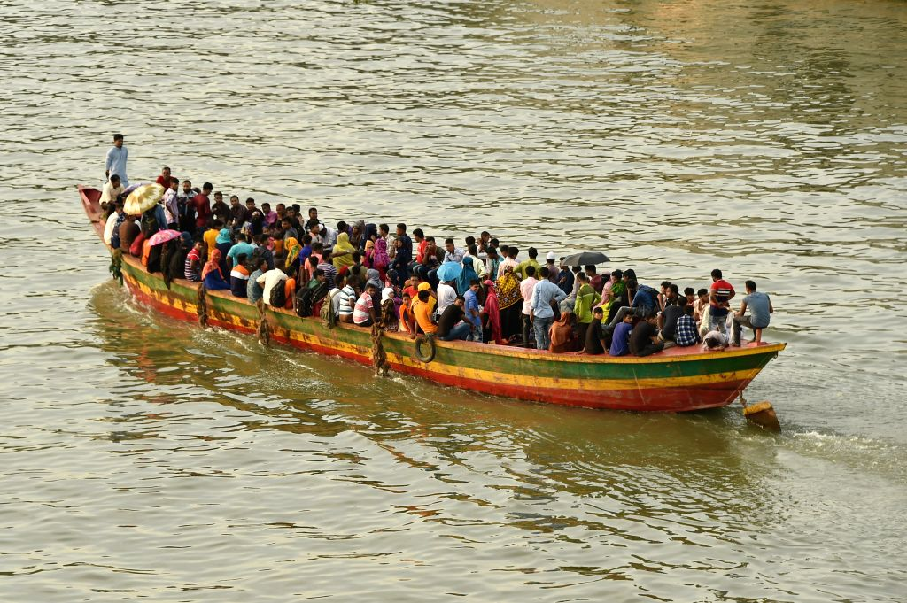 DHAKA, Aug. 10, 2019 - A small boat packed with travelers leaves the Sadarghat Launch Terminal in Dhaka, Bangladesh, Aug. 10, 2019. With the Eid al-Adha holiday approaching, hundreds of thousands of ...