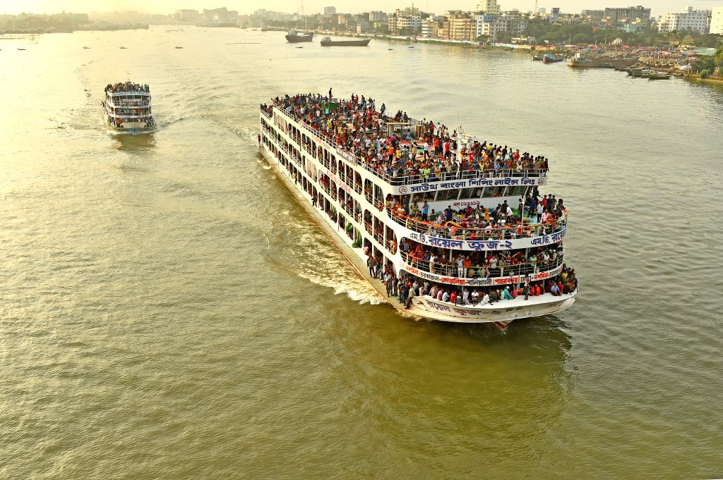 DHAKA, Aug. 10, 2019 - Ferries packed with travelers leave the Sadarghat Launch Terminal in Dhaka, Bangladesh, Aug. 10, 2019. With the Eid al-Adha holiday approaching, hundreds of thousands of ...